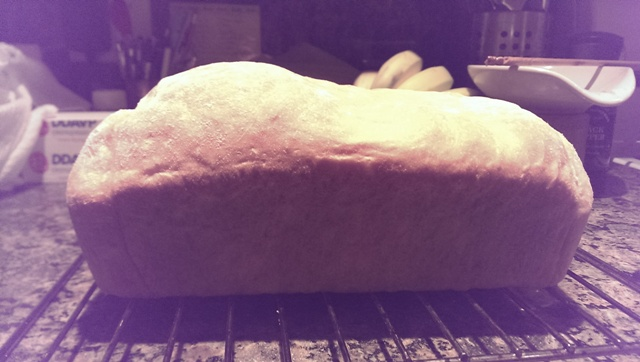 Collapsed right side of bread from overproofing